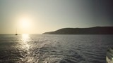 Boats and yacht sailing in the sea in Cyclades islands in Greece at sunset, for vacation and trip - 224355077