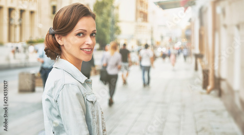 pretty smiling girl on a street in the city
