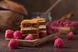 Quadro Layered honey cake with cream and raspberries.