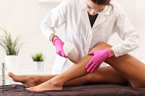 Foto Murales Adult woman having laser hair removal in professional beauty salon