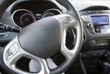 Closeup of Steering Wheel and Car Audio System in Modern Car