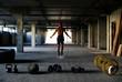 Athlete is engaged in crossfit in brutal gym