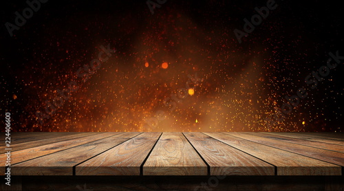 Wood table with flame effect on dark background.  - 224406600