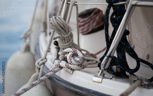 Boat tied to dock with ropes