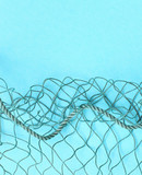 Fishing net with space for your text. Blue background for a fishery theme. - 224429631