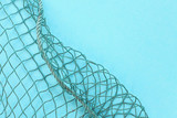 Fishing net with space for your text. Blue background for a fishery theme. - 224429699