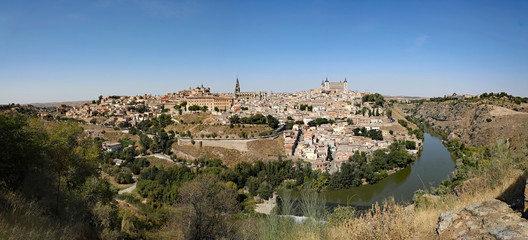 Aerial view of the ancient, walled city of Toledo, Spain, with the Tagus River. © Thomas Barrat