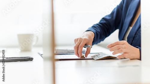 Closeup of accountant counting Euro coins and paper money © Gajus