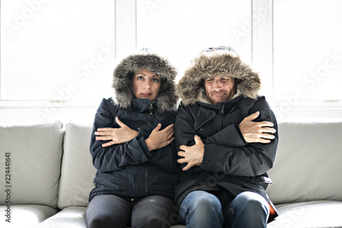 Foto Murales Couple have cold on the sofa at home with winter coat