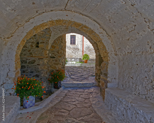 Greece, arched alley and old stone house in Crete island