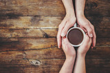 A cup of tea in the hands. Selective focus.