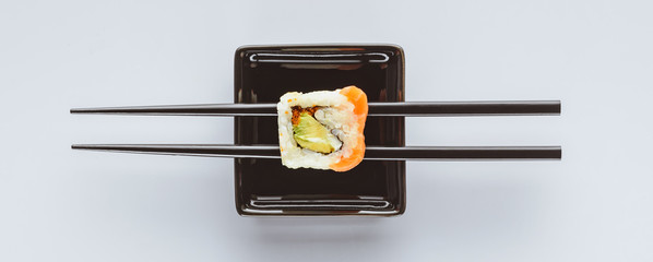 close-up view of tasty sushi and chopsticks isolated on white © LIGHTFIELD STUDIOS