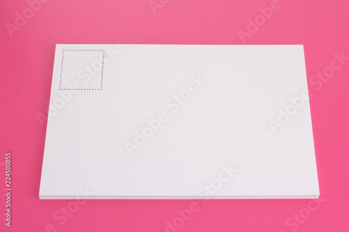 Postcard on the pink floor with copy space area. - 224500855