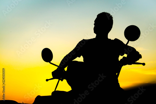 Silhouette on a motorcycle