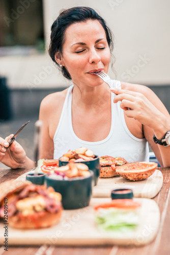 Young woman eating delicious meal. - 224509419
