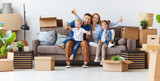 happy family mother father and children move to new apartment and unpack boxes - 224510083