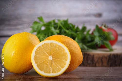 Foto Murales fresh lemons on wooden table