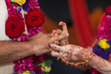 elements of Vedic wedding wearing rings close up