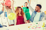 corporate, celebration and holidays concept - happy team with confetti and serpentine having fun at office party - 224545460