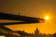 The floating bridge in park Zaryadye against bright sun in Moscow, Russia