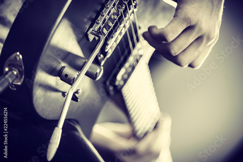 Close up of man playing on electric guitar - 224556214