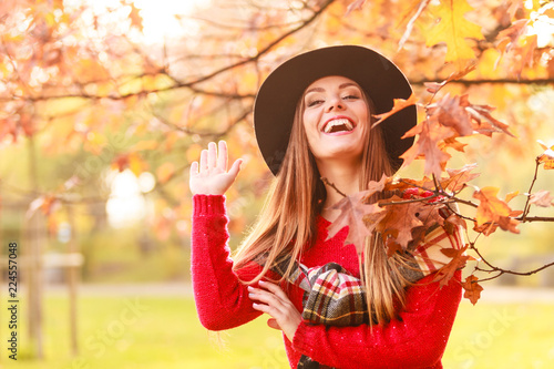 Foto Murales Woman walking in park during autumn