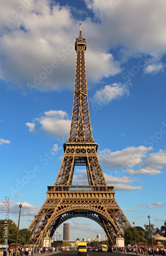 Very high Eiffel Tower and the blue sky with clouds - 224566242