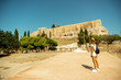 girl goes to the ancient Greek Acropolis
