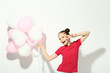 Beautiful young girl with balloons on white background