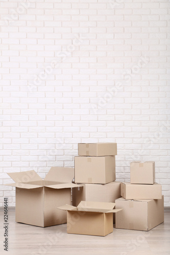 Cardboard boxes on brick wall background