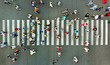 Pedestrian crossing top view. Crosswalk aerial from drone.