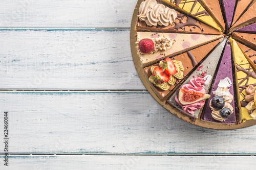 Top of view mini raw cakes on wooden table - 224660044