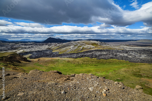 A beautiful Iceland landscape in summer, hills in the background.