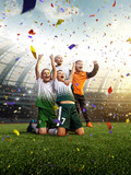 winning football player Children after score in a match confetti and tinsel - 224699803
