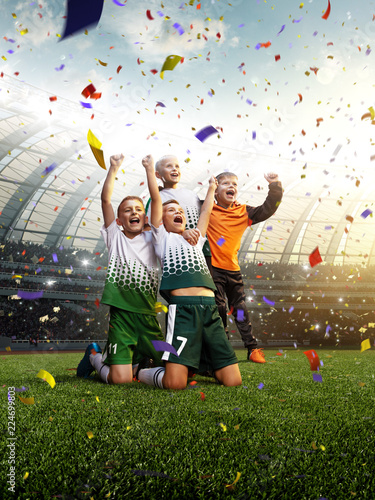 winning football player Children after score in a match confetti and tinsel