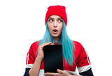 Bright young woman with new tablet looking shocked