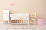 Stylish baby room interior with comfortable crib