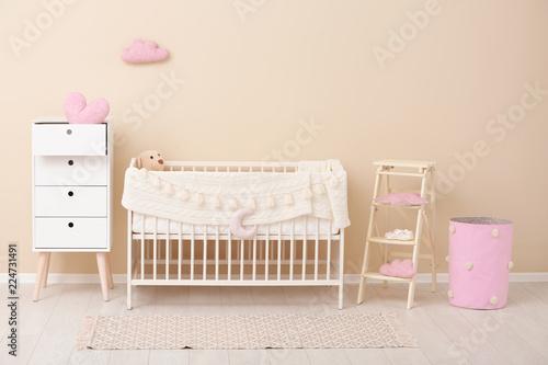 Leinwanddruck Bild Stylish baby room interior with comfortable crib