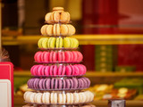 Closeup detail of multiple colorful macarons arranged on a tower at a French sweets and confectionery store. Shallow focus. Riquewihr, France. Travel and cuisine. - 224749407