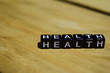 Health written on wooden blocks. Inspiration and motivation concepts. Cross processed image on Wooden Background