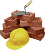 Bricks, hardhat and trowel