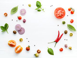The ingredients for homemade pizza on white wooden background. - 224800648