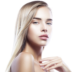 Close-up portrait of young beautiful girl model with nude make-up, clean skin, blond hair style touching body, on white background. Skincare facial treatment concept