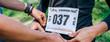 Leinwandbild Motiv Girl placing the race number
