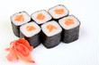 Rolls of Syak maki. Japanese food on a beautiful dish. Dietary food. An exquisite Japanese dish. Fresh dish of fish.