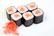 Rolls of Syak maki. Japanese food on a beautiful dish. Dietary food. An exquisite Japanese dish. Fresh dish of fish.