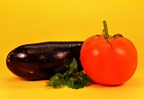 Ripe purple eggplant, tomato and parsley leaf isolated on a yellow background - 224847286