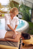 Woman at the spa getting a massage.