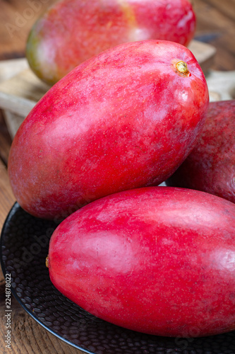 Foto Murales National fruit of India, Pakistan, and Philippines tropical organic ripe red mango ready to eat