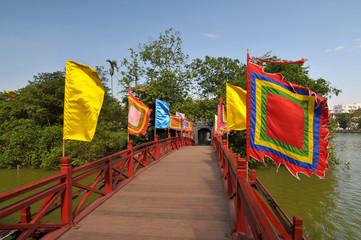 The Huc Bridge near Hoan Kiem Lake in the historical center of Hanoi, the capital city of Vietnam.